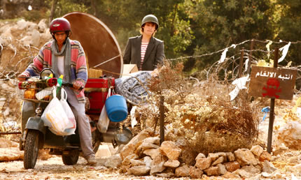 Two young men transport belongings on a motdobike