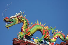 an ornate and undulating statue of a green Chinese dragon
