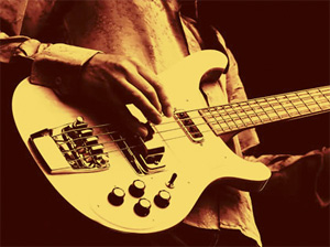 A gold-tinted closeup of a musician's hand playing an electric guitar