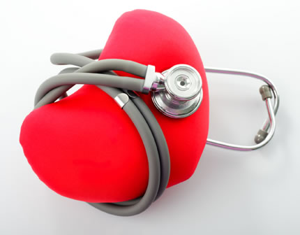 a big red heart-shaped pillow wrapped in a stethoscope