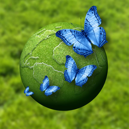 In this surreal colourful image, brilliant blue butterflies on a vibrant green model earth