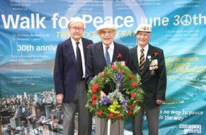 three veterans with wreath