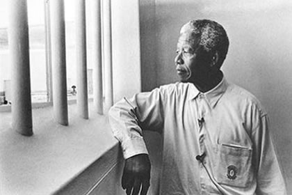 Nelson Mandela looks out former prison cell